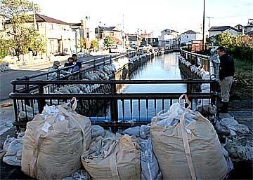 瀬上川氾濫の要因は異常潮位?:...